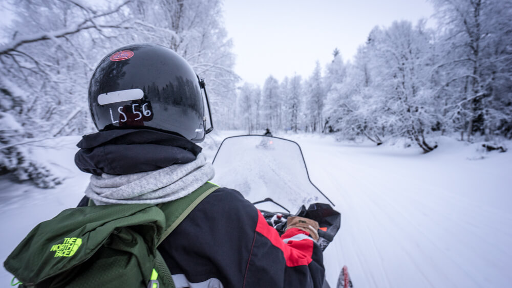 snowmobiling in lapland