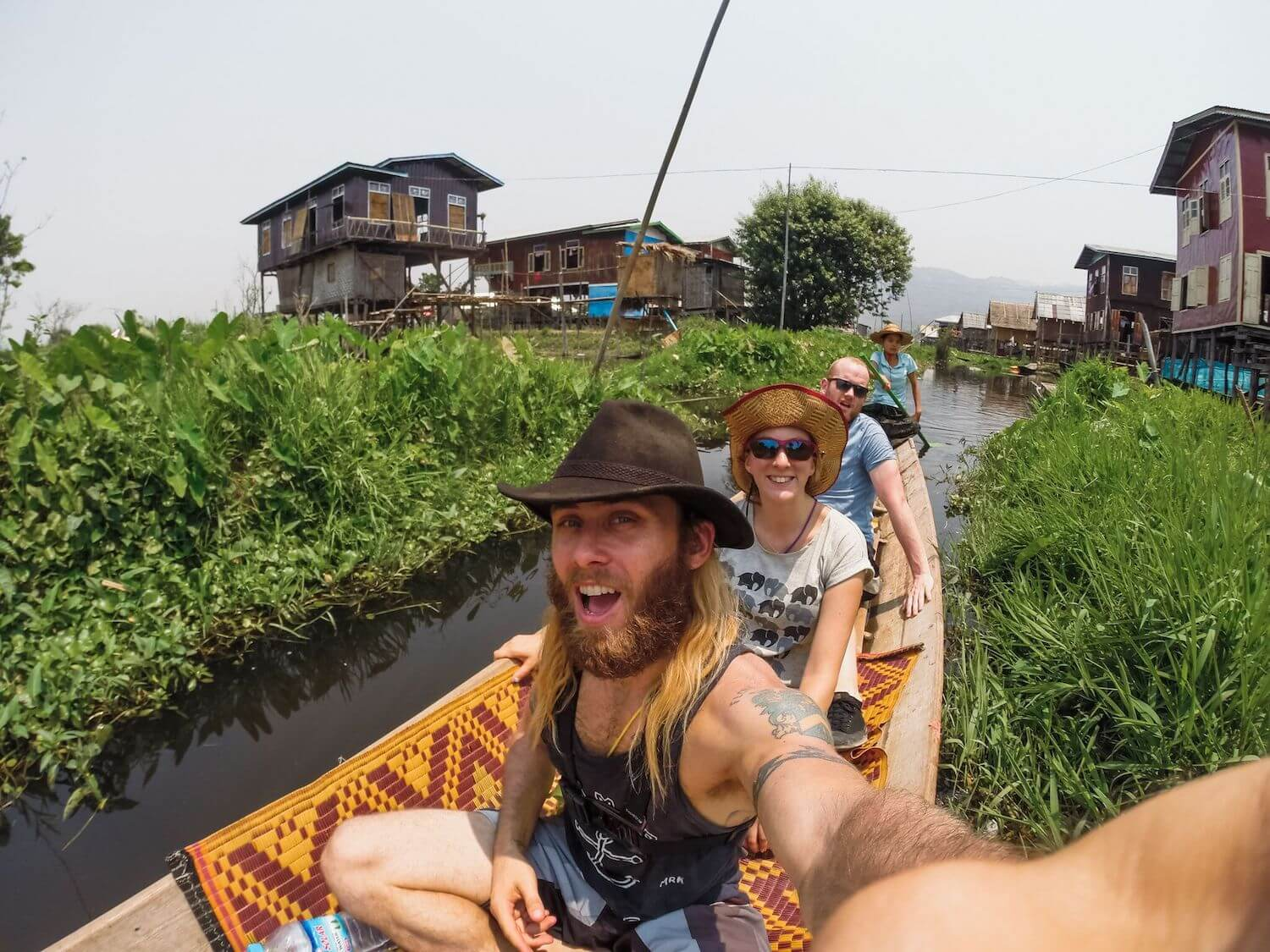 Best Myanmar Itinerary: Photo in a canoe in Inle Lake and the floating stilt houses. Photo taken by Ryan Brown of Lost Boy Memoirs with GoPro Hero 3+, edited in Adobe Lightroom.