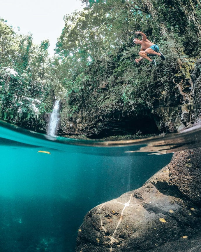 10 top things to do in Samoa - Tom jumping into Afu Aua Waterfall pool
