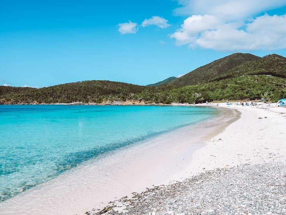 fluffy white sand and bright blue water of salt pond bay beach in virgin islands national park