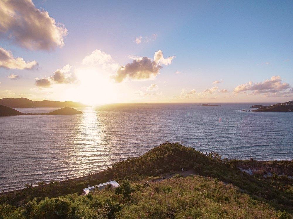 sunrise on horizon of coral bay in virgin islands national park