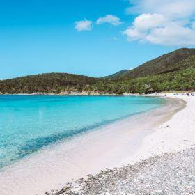 Bright blue, clear water against white sand at Salt Pond Beach in St John