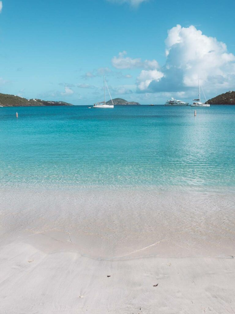 View of turquoise water and boats looking out to Magens Bay